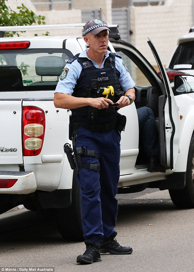 Raptor 13 (pictured outside Hawi's funeral) is part of an elite militarised police unit which tackles violent bikie gangs