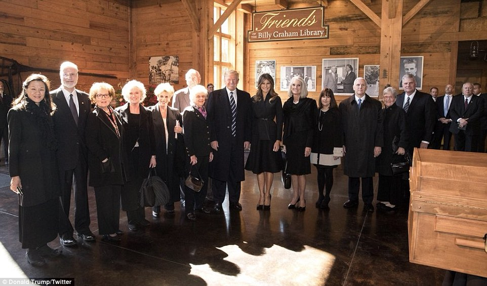 Family affair: President Trump poses with Billy Graham's children and their spouses as well as Melania and the Pences on Friday (above)
