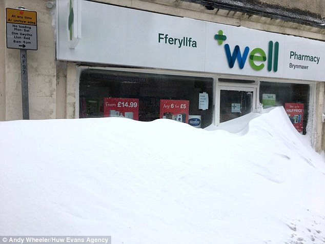 Shop fronts blocked by snow drifts in Brynmawr, South Wales, illustrated just how badly  the big freeze affected Wales