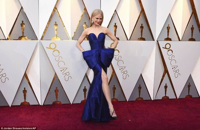 Leggy day: Nicole Kidman also chose blue, but opted for a darker version; she sported a strapless version with a textured midsection and a thigh-slit