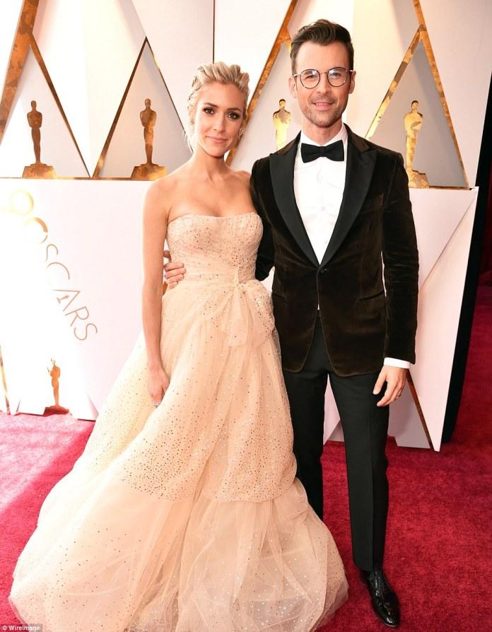 Now with Brad: The jewelry designer posed arm in arm with celebrity stylist Brad Goreski