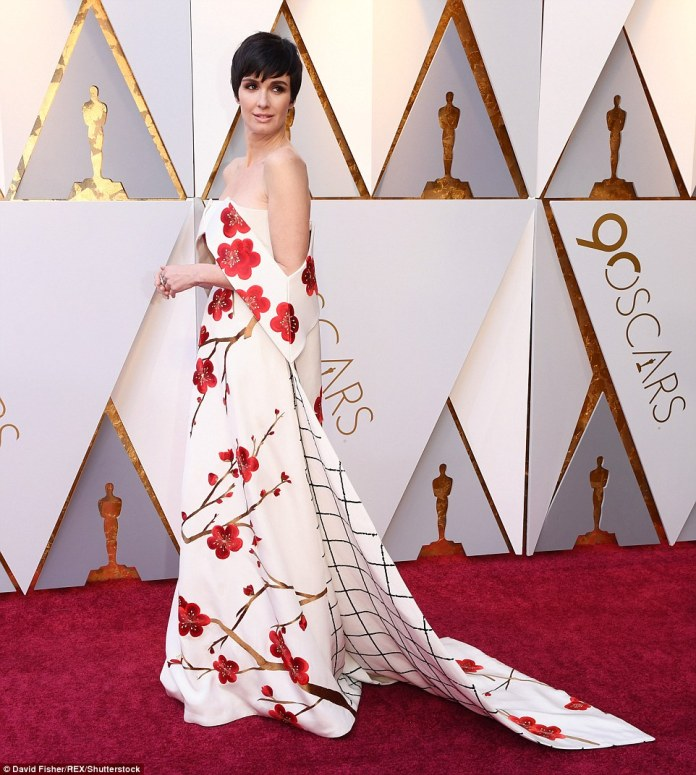 Paz Vega chose a floral and geometric patterned dress featuring off-the-shoulder sleeves; the dress is by Christopher Bu