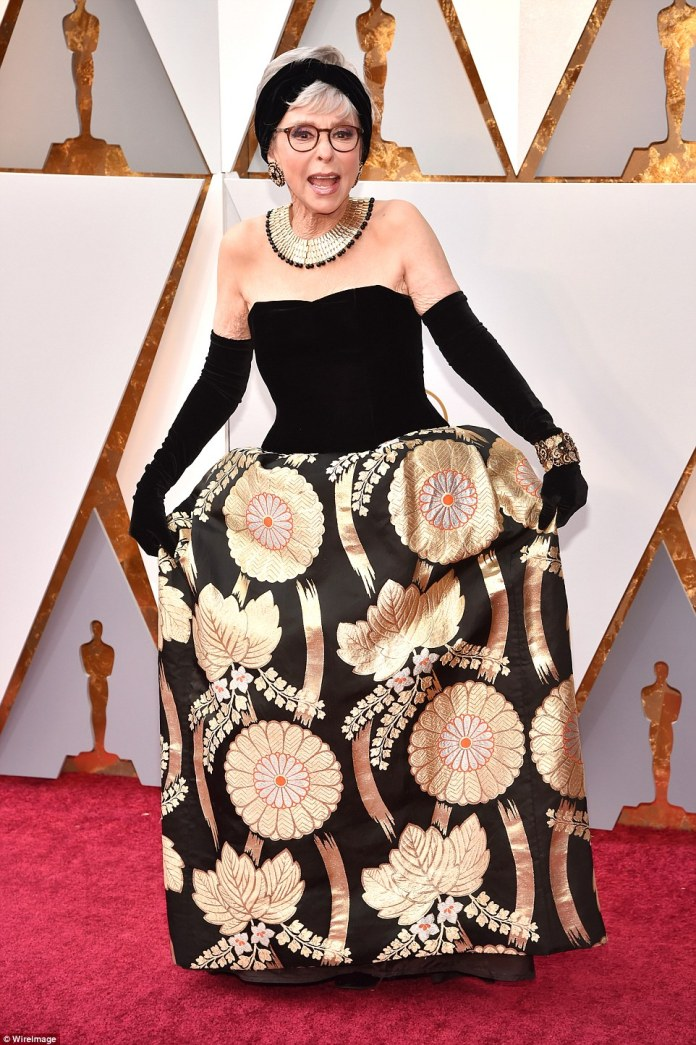 Having fun: Rita Moreno chose a floral patterned number, adding gloves and a headband