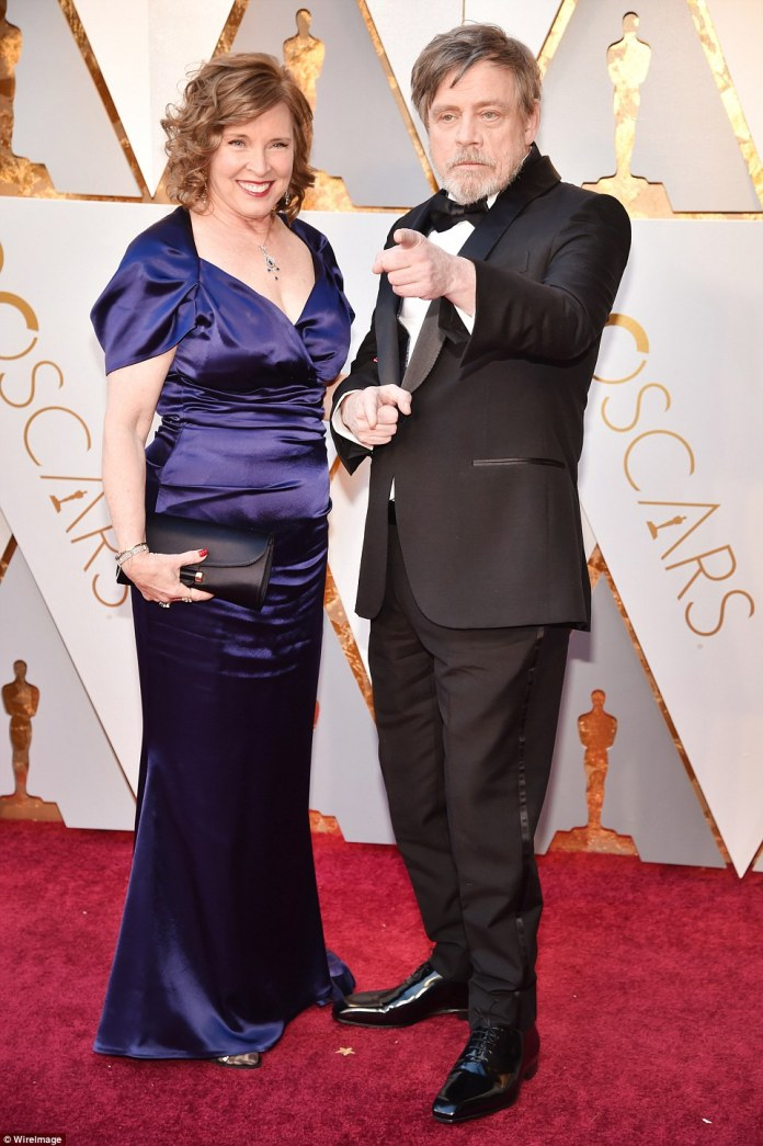 Also at the awards show: Mark Hamill and his wife Marilou arrived in a deep blue look with dramatic sleeves