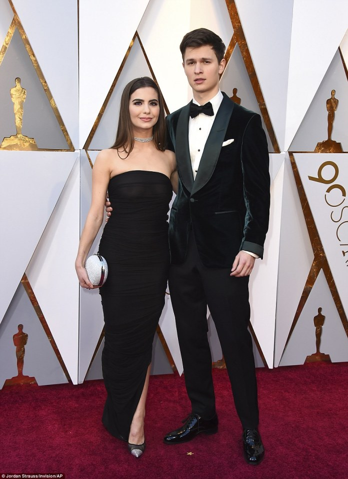 Good times: Ansel Elgort, in Tom Ford, posed with a beautiful girlfriend Violetta Komyshan on the red carpet; Violetta kept it chic in a classic black dress with a diamond choker