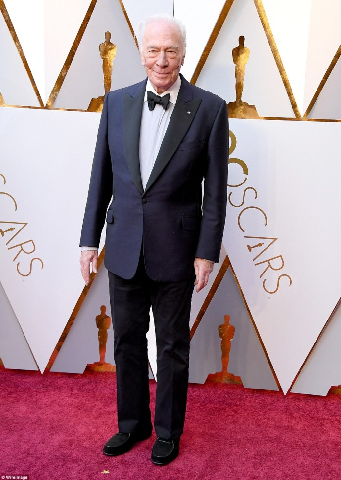 Looking sharp: Christopher Plummer chose a navy and black suit with a white button up and dark hued dress shoes
