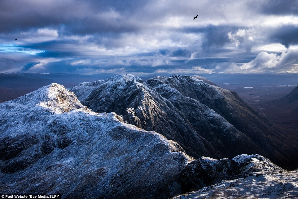 Another winning entry by Paul Webster: Showing Aonach Eagach, above Glen Coe, Paul said a bright and crisp sunny day had been forecast, but any initial disappointment about the dark clouds evaporated when this view along the ridge was suddenly revealed, with two ravens circling the summit