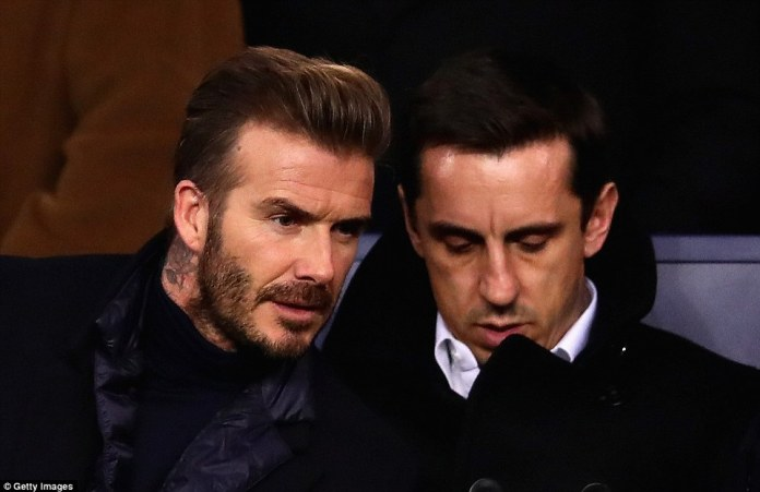 Former Manchester United and England pair David Beckham and Gary Neville watch on from the stands in the French capital