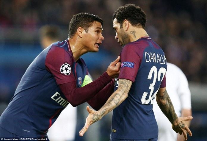Paris Saint-Germain captain Thiago Silva berates compatriot and team-mate Dani Alves during the first half on Tuesday night
