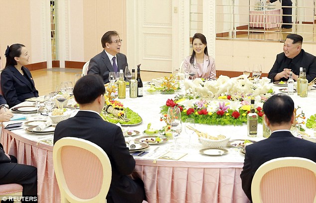 Special guests: Kim Jong Un sits next to his wife Ri Sol-Ju, with his sister Kim Yo-Jong sat to the right of  one of the South Korean diplomats during a meal hosted by North Korea