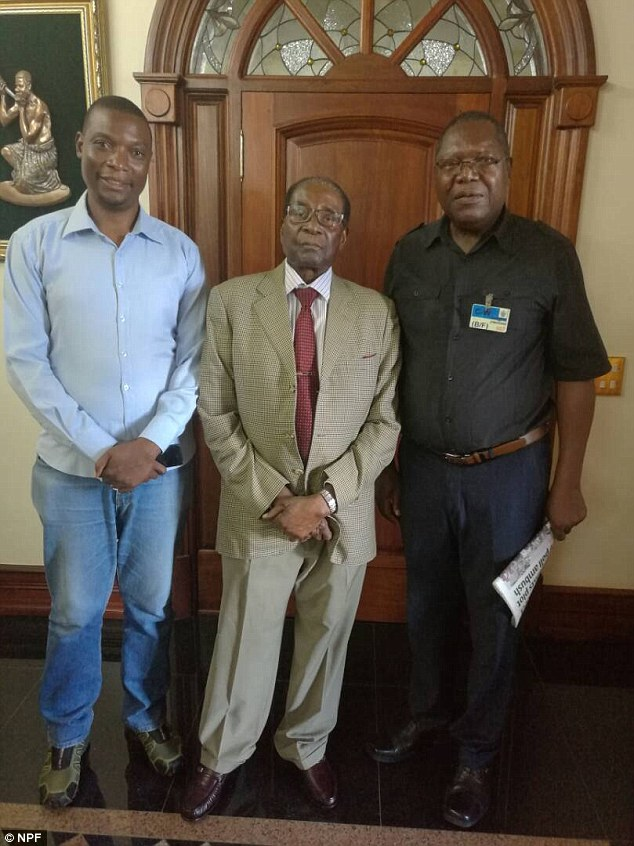 Robert Mugabe (centre) pictured recently with Zimbabwean opposition leader Ambrose Mutinhiri (right)