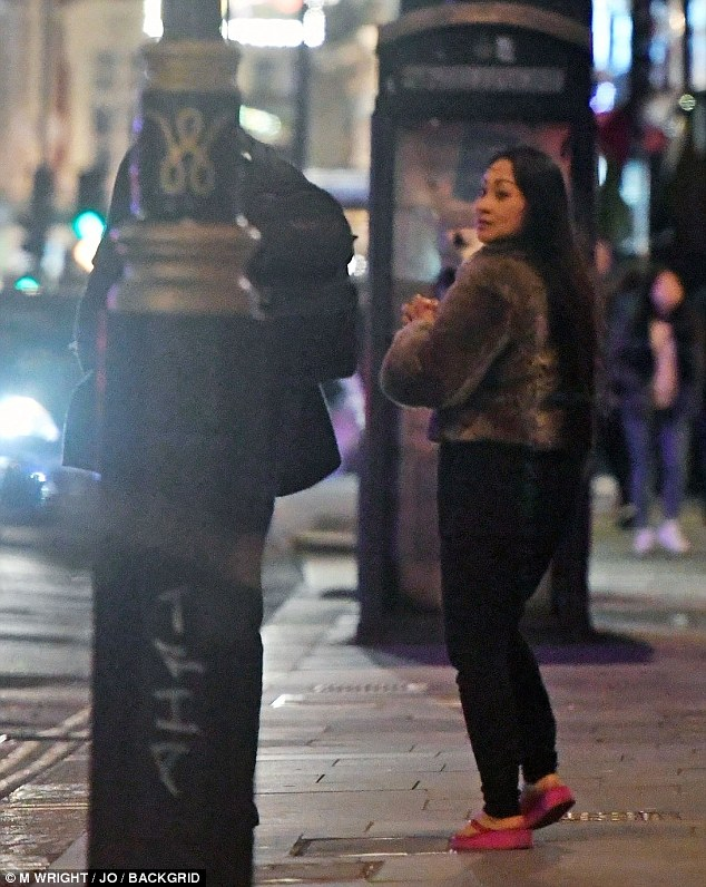 The woman can be seen glancing over her shoulder as the pair make their way through the streets