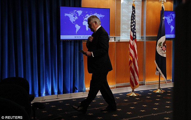 Final act: Tillerson said he will return to 'private life' after 14 months of turbulent leadership of the State Department and refused to take questions as he left the podium