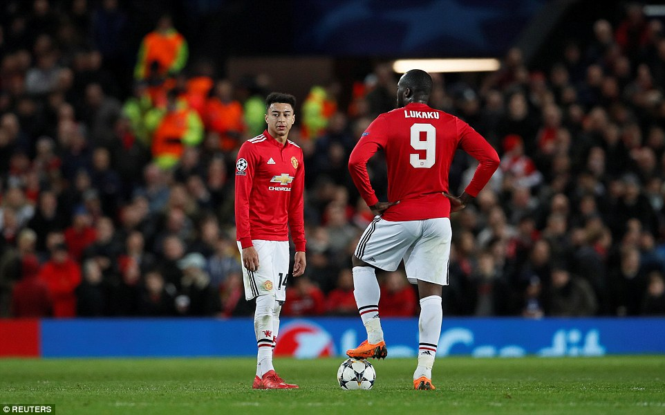 A dejected Jesse Lingard and Romelu Lukaku prepare to take kick off after United fell behind at Old Trafford