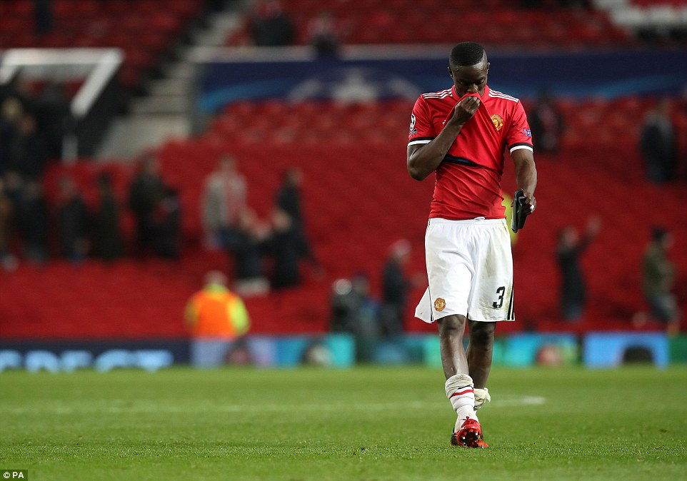 Eric Bailly is clearly upset following full-time as Old Trafford empties out behind him on a demoralising evening for the club