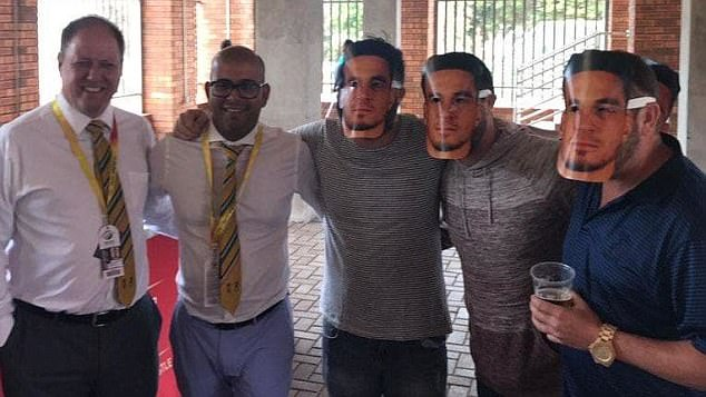 Cricket South Africa was forced to apologise after two officials posed for a photograph with fans wearing Sonny Bill Williams masks intended to mock Warner