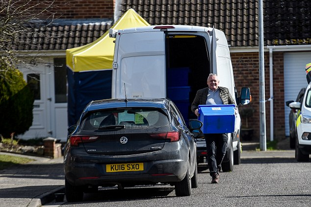 A police officer carries a box outside Sergei Skripal's house in Salisbury. On March 9, Skripal's cul-de-saq in Salisbury was sealed off as police worked on the thesis that the nerve agent was posted through his letterbox