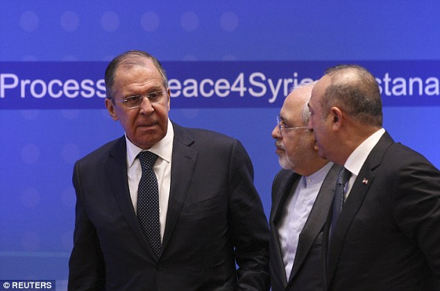 Russia's foreign minister Sergei Lavrov (left), speaking in Kazakhstan, said Mr Williamson may 'lack education'