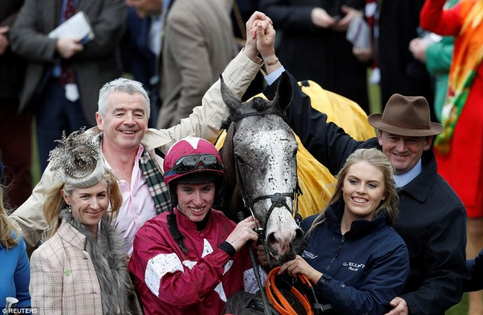 Victory parade! Jack Kennedy celebrates after winning the 13.30 JCB Triumph Hurdle on Farclas
