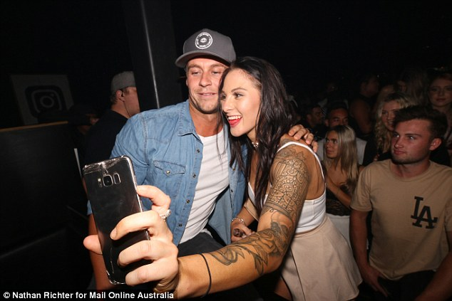 Have I seen you before? Ryan posed for a snap with a tattooed Davina Rankin lookalike