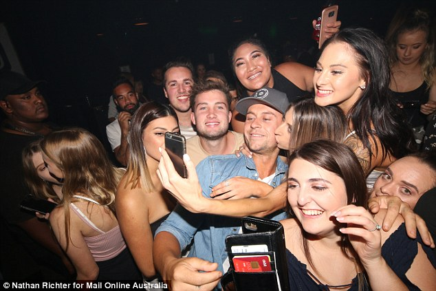 Somebody's popular! A seemingly endless stream of young ladies were asking for photos with the tradie and one eager MAFS fan even planted a kiss on his cheek