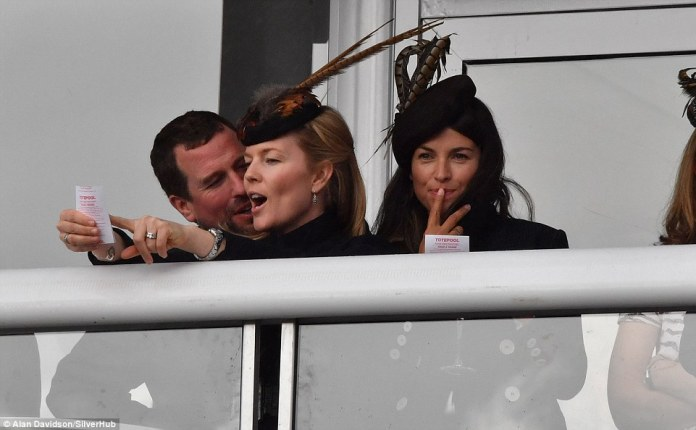 Autumn Phillips put on an animated display as she pointed to her betting slip as husband Peter Phillips looked on