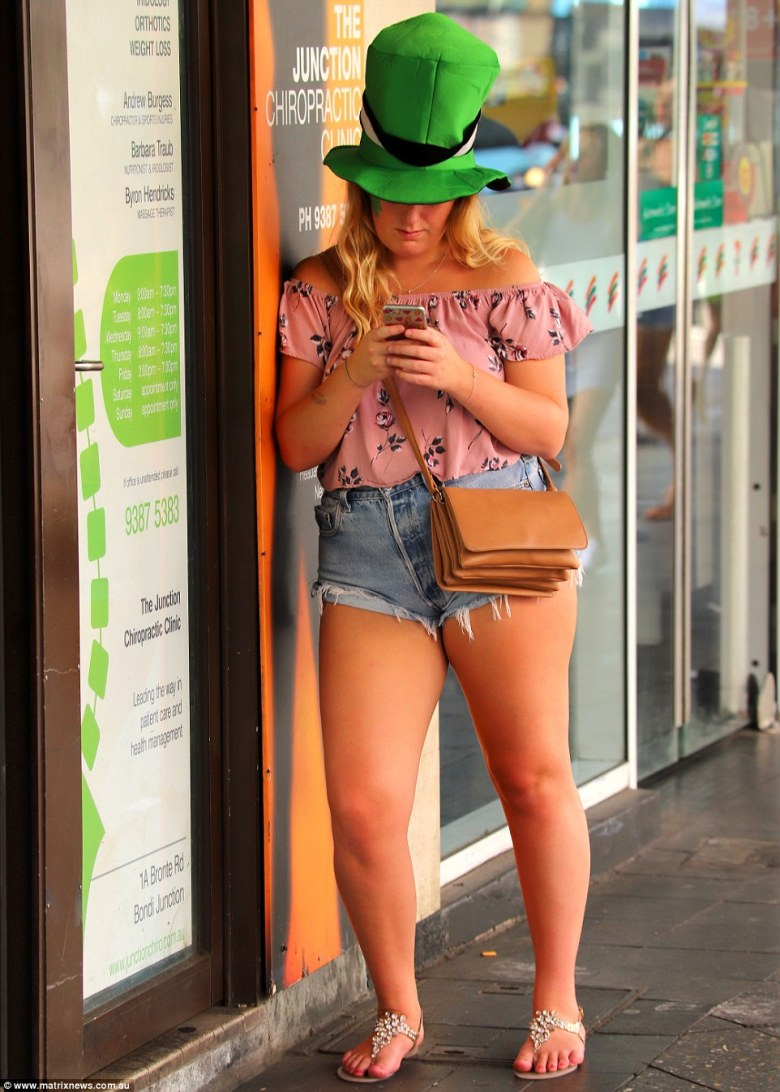 Huge hats were a popular sight through the Australian city on Saturday as were quirky, yet temporary, face tattoos (pictured)