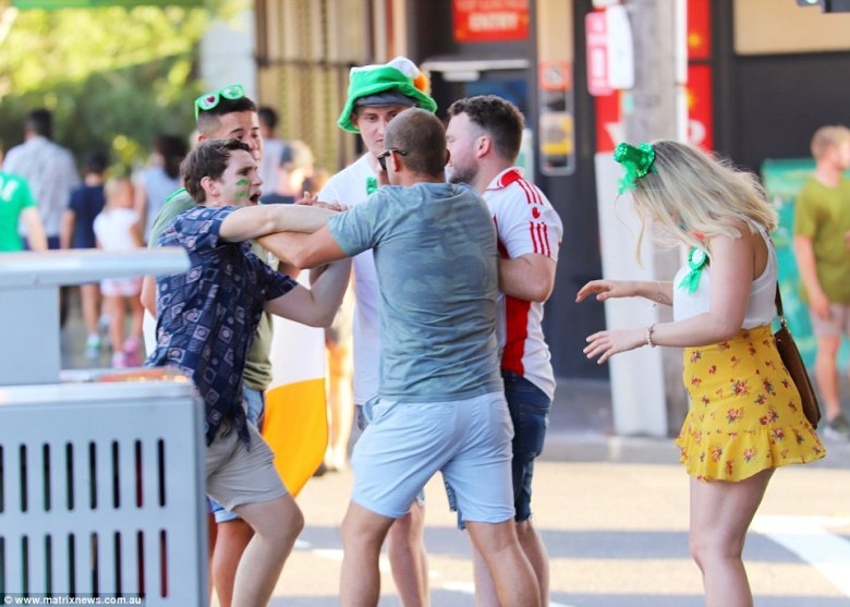 Despite the large crowds, at least five people appeared to get into an argument beside a garbage bin on the streets of Sydney