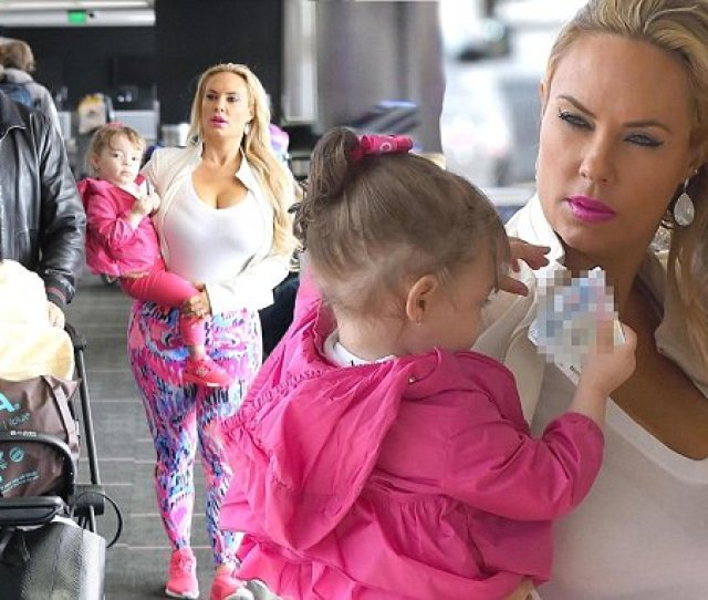Mom On The Go Coco Austin Puts On Busty Display In Sheer White Top As She Jets Out Of La With Husband Ice T And Daughter Chanel