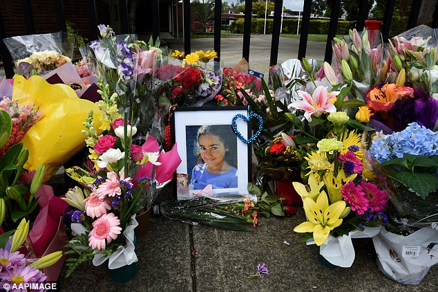 A floral tribute to Tia Palmer at the gates of Marsden State High School in November 2015
