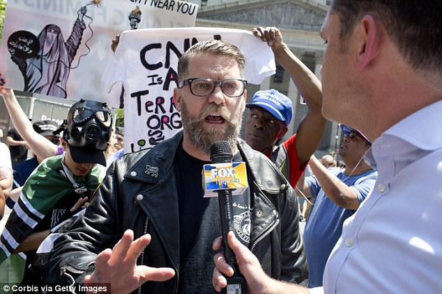 Proud Boys founder Gavin McInnes (centre) says the 'Western chauvinist' group is not racist