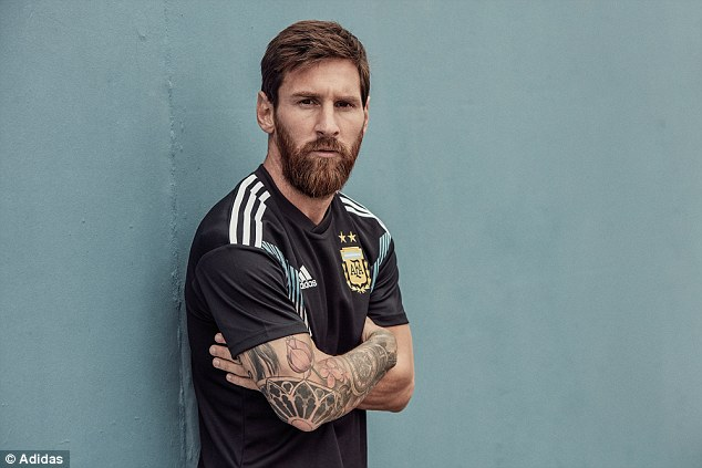 Argentina star Lionel Messi shows off their new change kit - a black design for the first time
