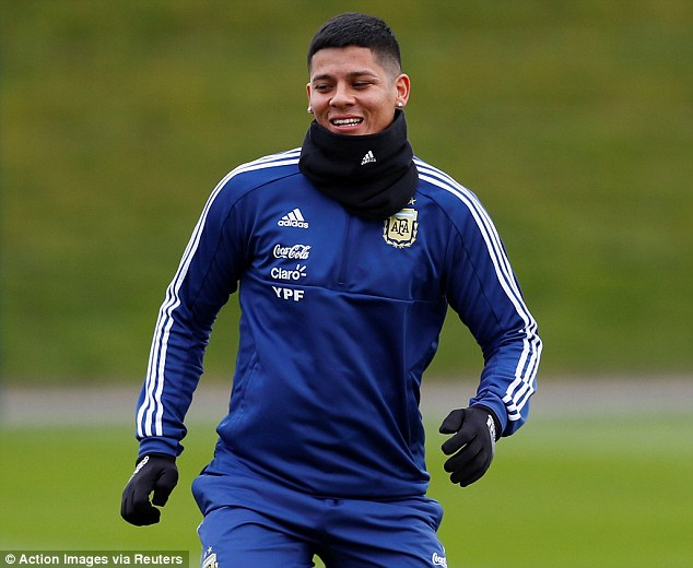 Manchester United man Marcos Rojo didn't have to travel far to link up with the squad