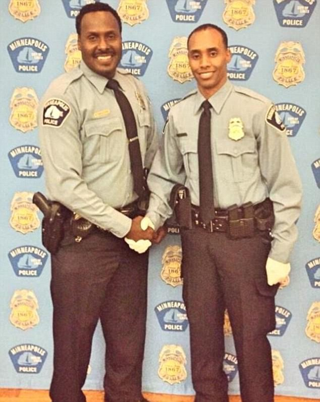'Thrown under the bus': Mohamed Noor (pictured, right) says his fellow officers are not backing him