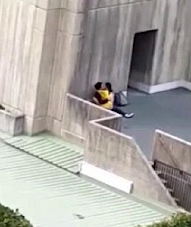 A pair of Asian university students have been filmed getting particularly amorous with each other in broad daylight at University of New South Wales