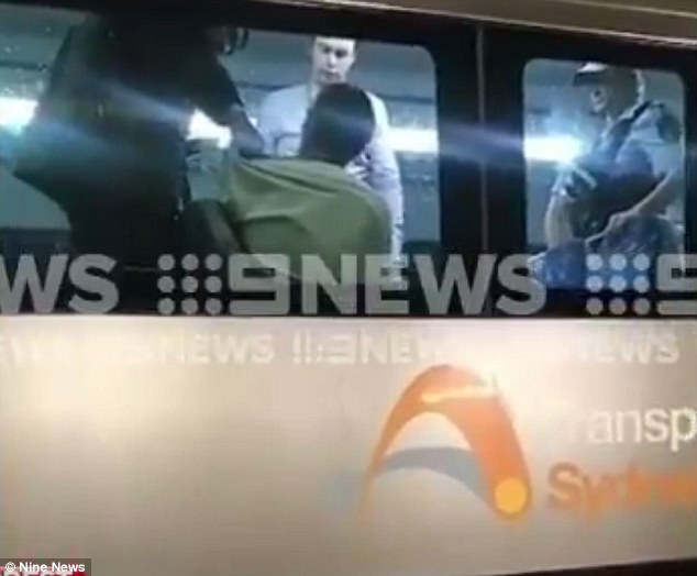 A man has sparked chaos at a busy Sydney train station after reports he carried a gun on board
