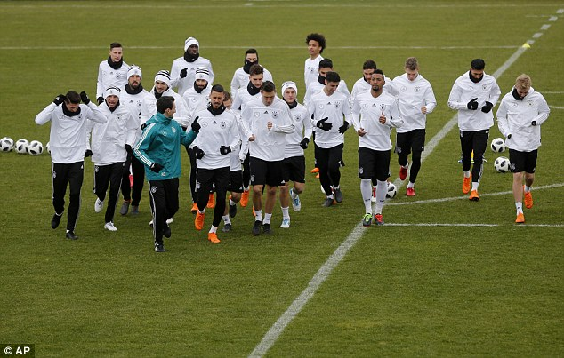 The Germany squad go for a jog during training as they prepare to face Spain and Brazil