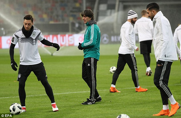 Mesut Ozil (left) trained with his Germany team-mates ahead of their match against Spain