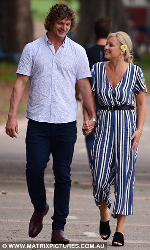 he donned a short-sleeved printed shirt and navy trousers teamed with tan boots