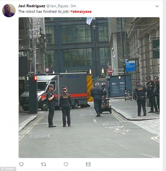 Another image taken by a witness and posted on Twitter shows the bomb robot surrounded by police