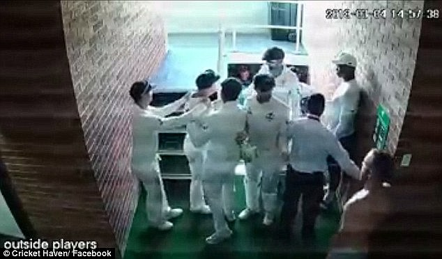 The video shows Warner being restrained by team-mates Usman Khawaja and Nathan Lyon as he directs a verbal barrage at de Kock