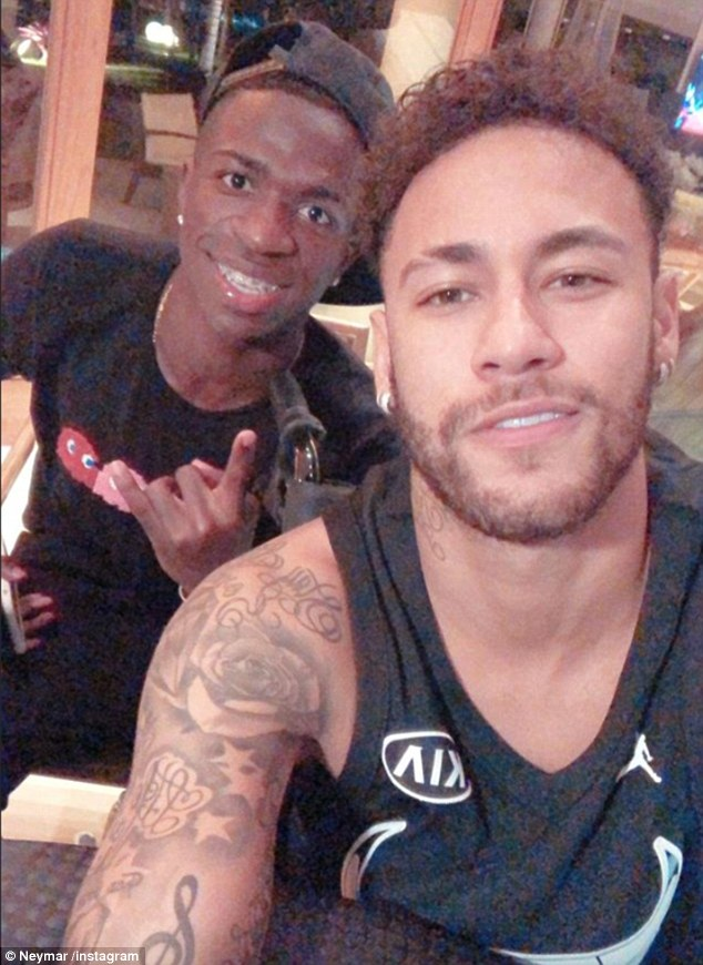 A wheelchair-bound Neymar poses alongside Vinicius, who will move to Real Madrid in July