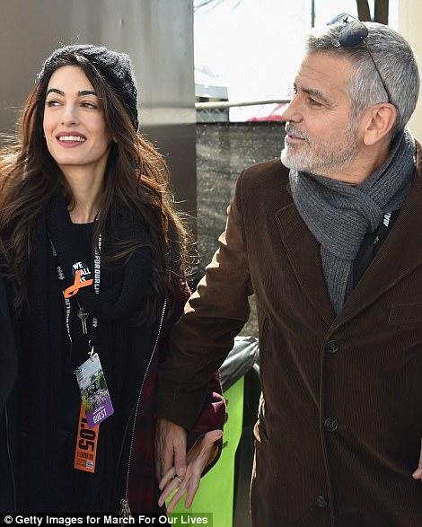 George and Amal Clooney are pictured at the Washington DC March For Our Lives protest on Saturday. They donated $500,000 to the event