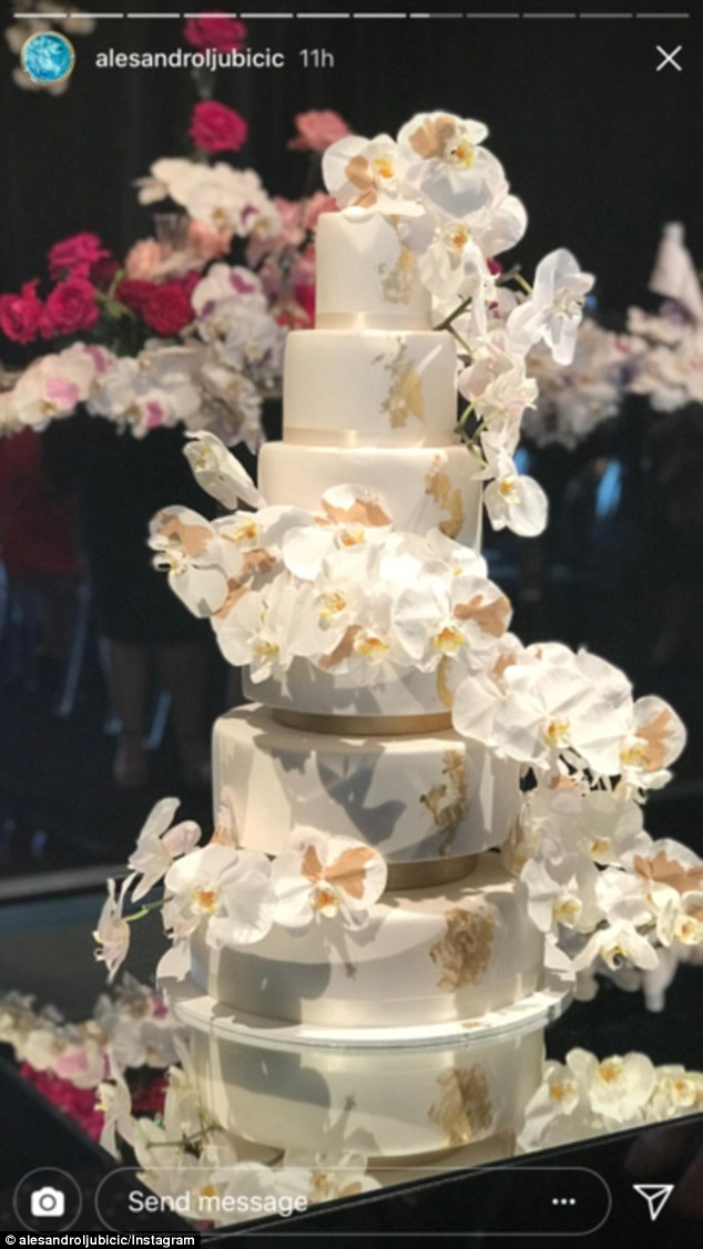 What a cake! The pair chose a white and gold six-tier cake
