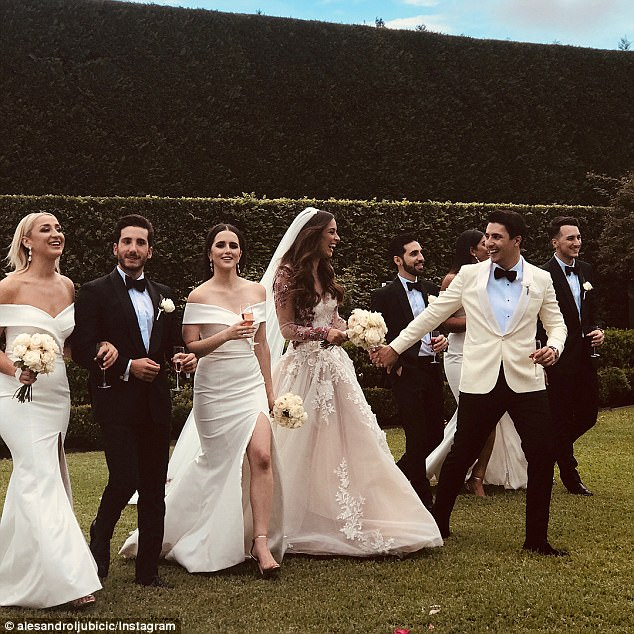Looking sharp! Alesandro looked dapper in black trousers and a cream blazer, which he wore with a white shirt and a black bow tie. Monika's bridesmaids wore figure-hugging white dresses, with leg splits