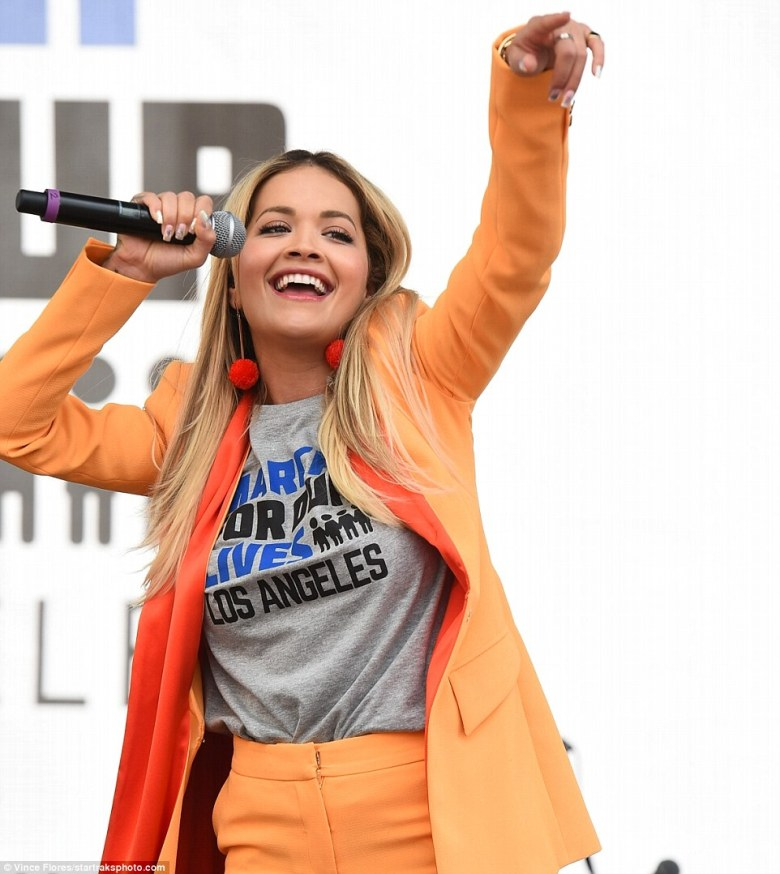 British singer Rita Ora also turned up to the protest, sporting an attention-grabbing bright orange ensemble