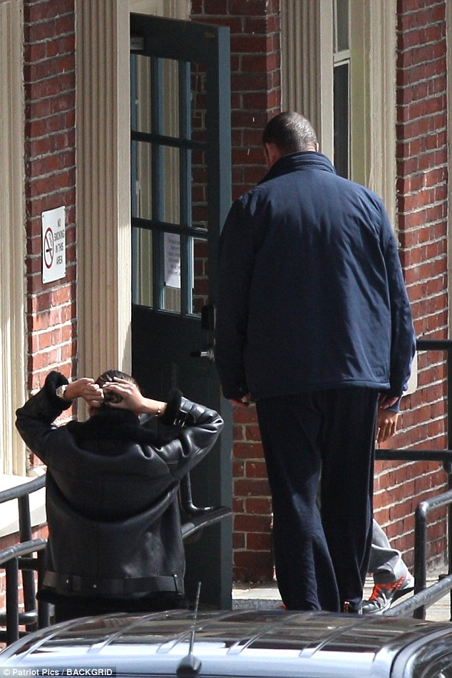 James Packer spotted entering one of the buildings of a  psychiatric hospital in Boston, where he has checked in, with a friend who was seen being dropped off earlier in the day