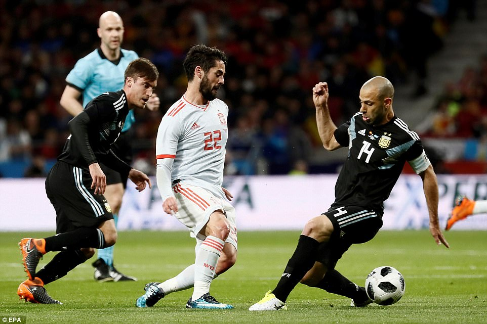 Isco (centre) takes on Argentina captain Javier Mascherano as Spain went 2-0 ahead in the opening 26 minutes of the game