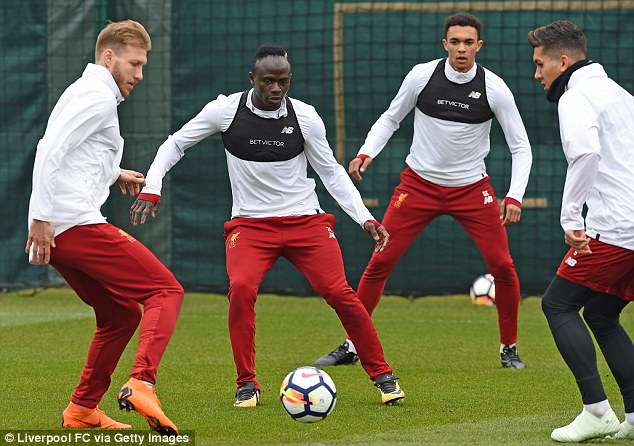 Electric winger Sadio Mane looks on as Ragnar Klavan and Roberto Firmino battle for the ball