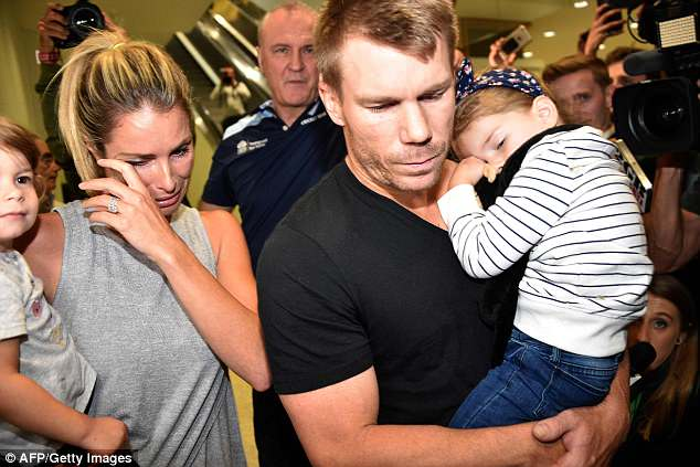 Under the spotlight:Disgraced sportsman David was greeted by his sobbing wife Candice and their two young daughters as he made his way through Sydney airport on Friday night
